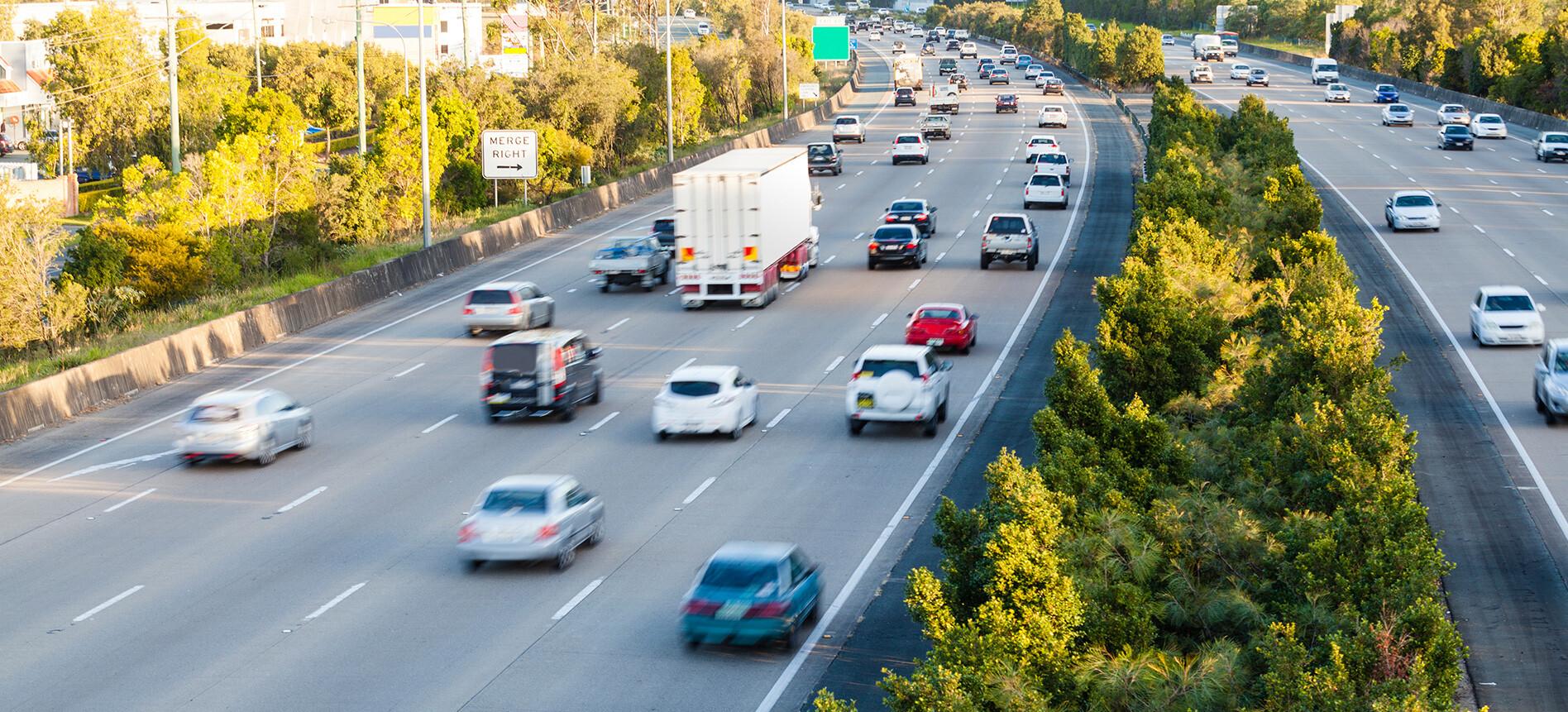 Cars Driving On Freeway Jpg