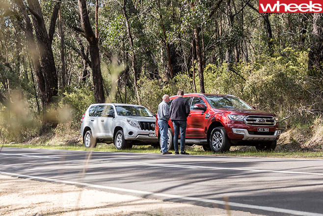 Ford -Everest -and -Toyota -Prado -parked -side -road