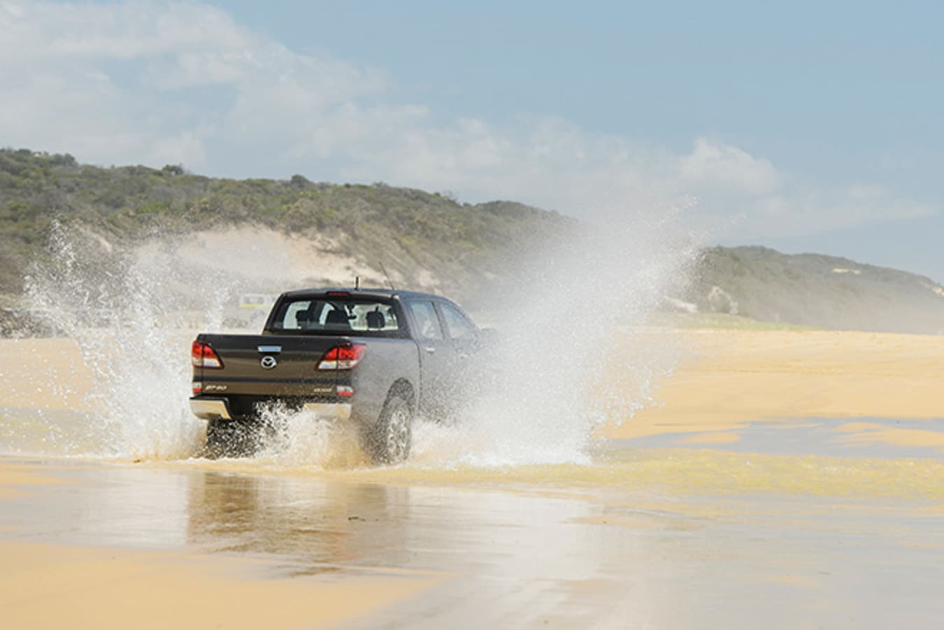 Mazda BT-50 at Fraser Island rear driving on sand water