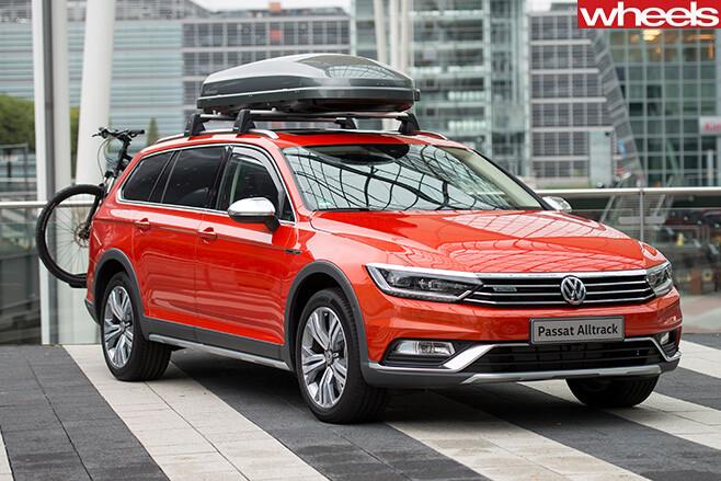 Red -Volkswagen -Passat -Alltrack -front -city-