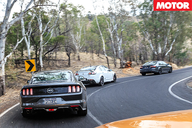 3 modern muscle cars rear driving