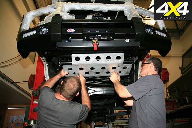 Fixing a steering guard to underside of 4x4