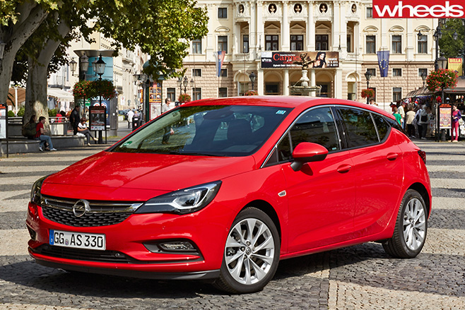 Red -opel -astra-