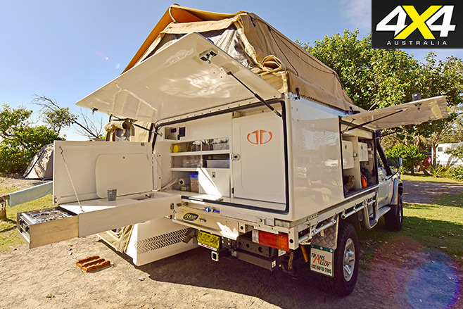 Custom canopy with comprehensive storage system