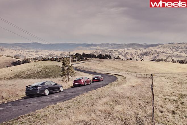 2012-FPV-GT-R-Spec -vs -Chrysler -300-SRT8-vs -HSV-Clubsport -R8-driving -rear -side