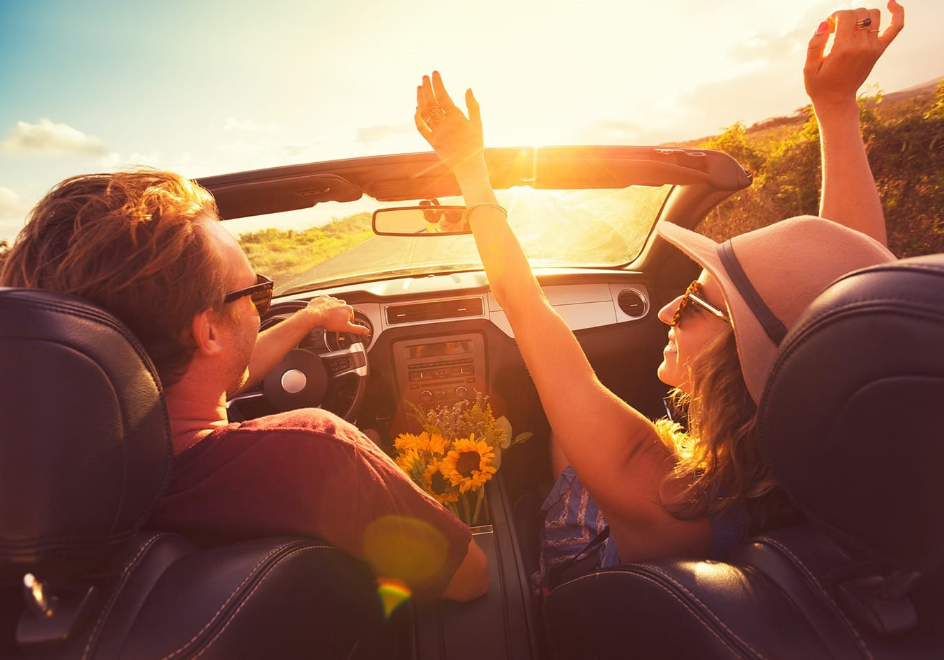 Happy Couple In Convertible In Sun Laughing Jpg