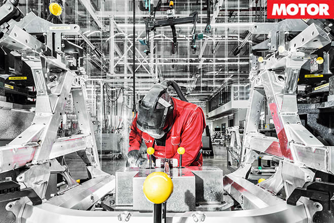 Workers soldering audi r8 chassis