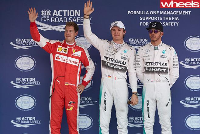Hamilton -standing -on -podium -with -sunglasses