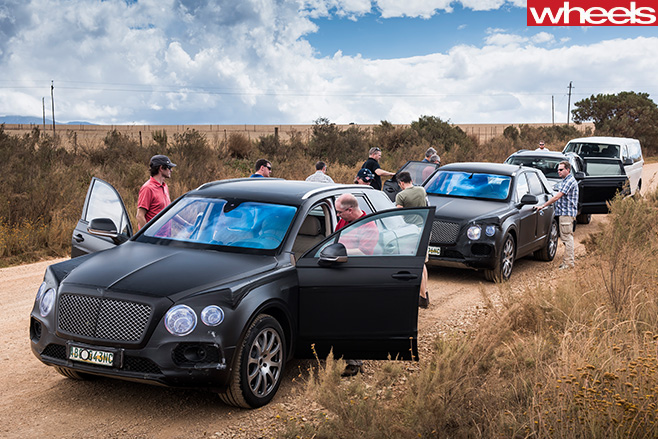 Bentley -Bentaygas -parked -on -dirt -trackjpg