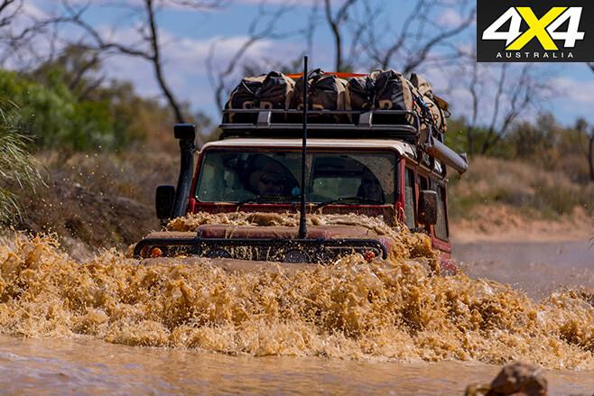 Defender driving through -creek