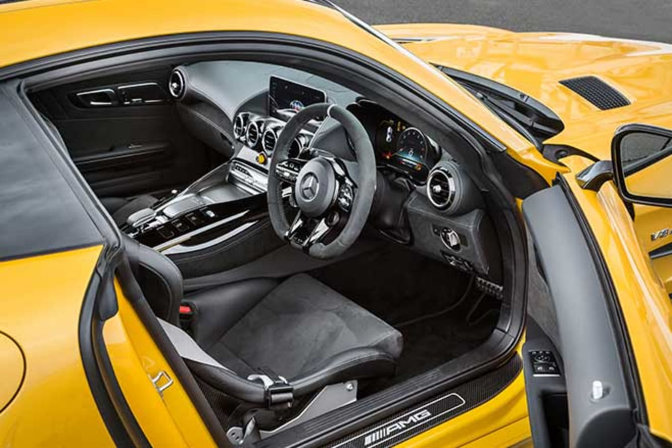 Four-point harnesses are standard in the GT R Pro.
