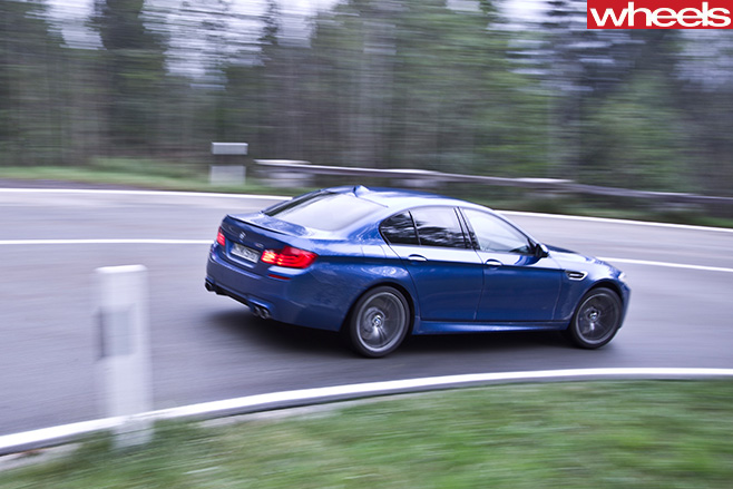 BMW-M5-driving -in -Germany -driving -rear -side