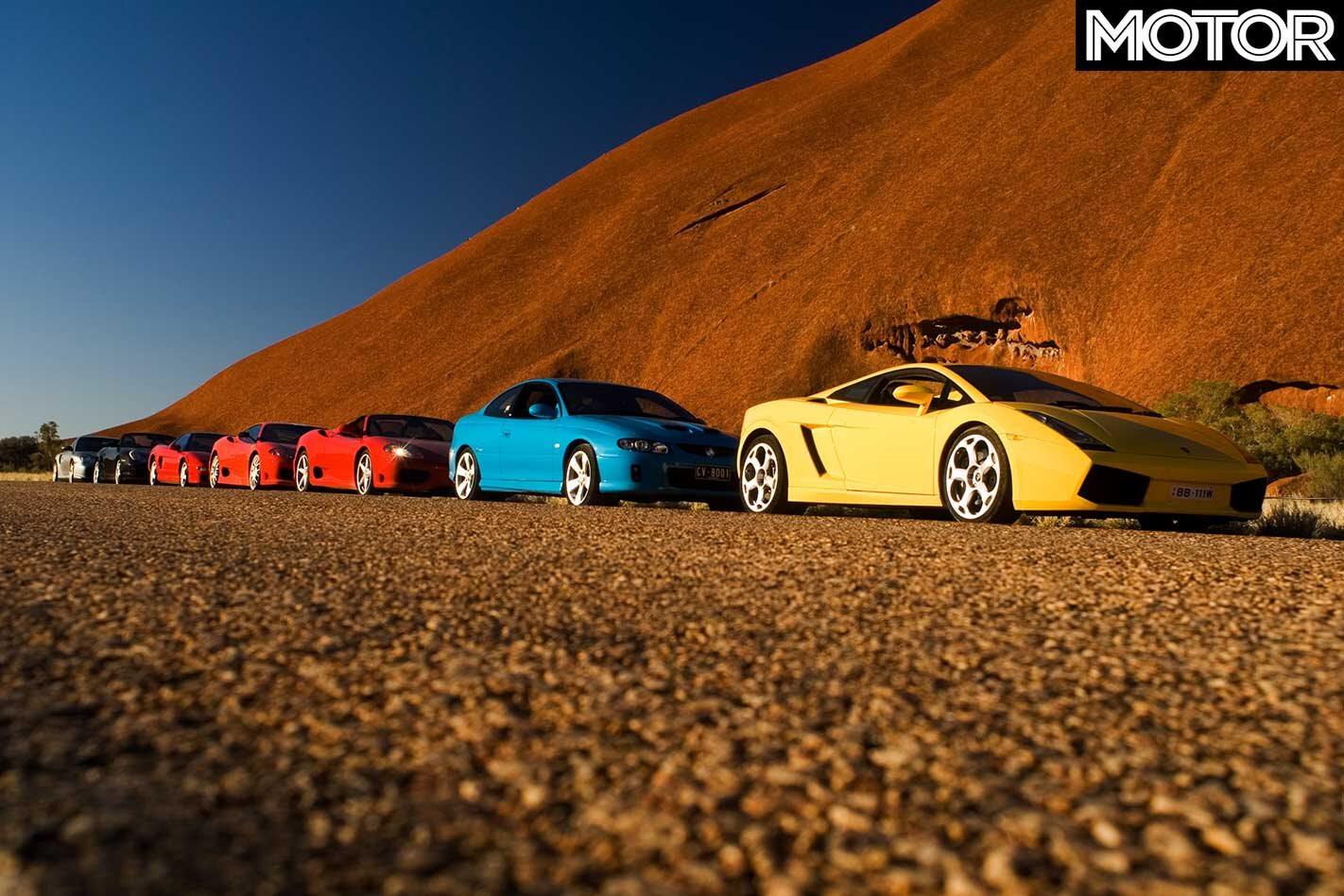 Supercars parked at Uluru