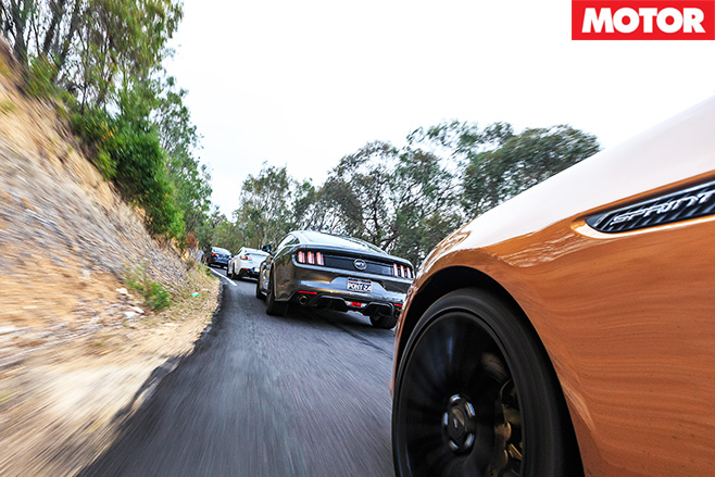 Modern muscle cars driving