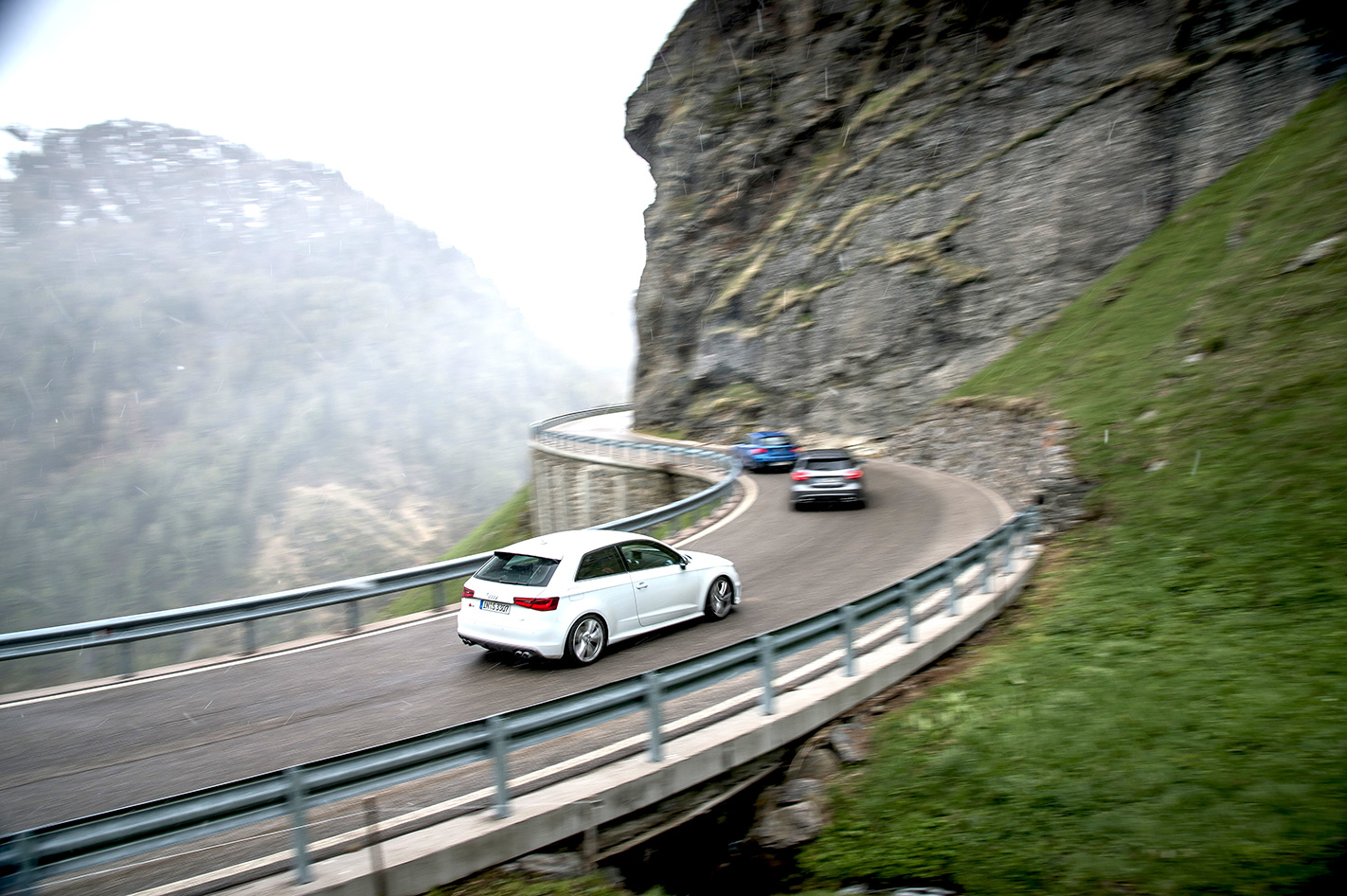 Audi S3 vs BMW M135i vs Mercedes A45 AMG on road.jpg