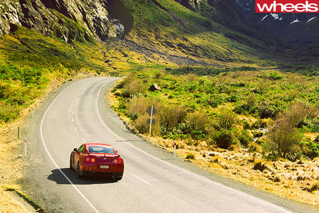 Nissan -GT-R-rear -driving -road -mountains