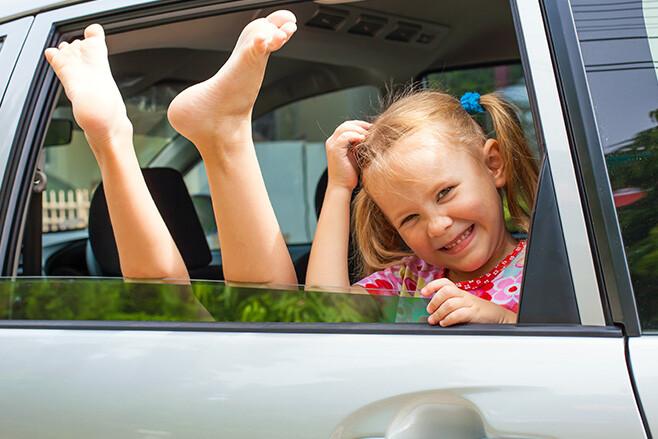 Children in back seat of car