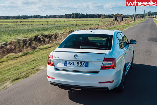 Skoda -Octavia -white -driving -rear