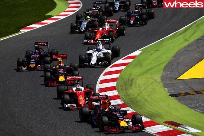 F1-race -cars -driving -around -circuit