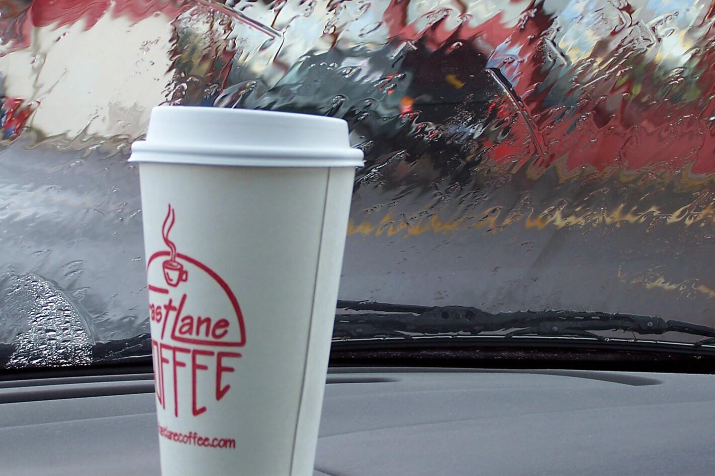 Coffee Cup On Car Dash Jpg