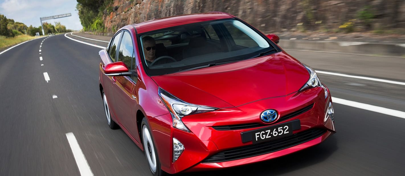 Toyota Prius Driving Around Front Side Jpg