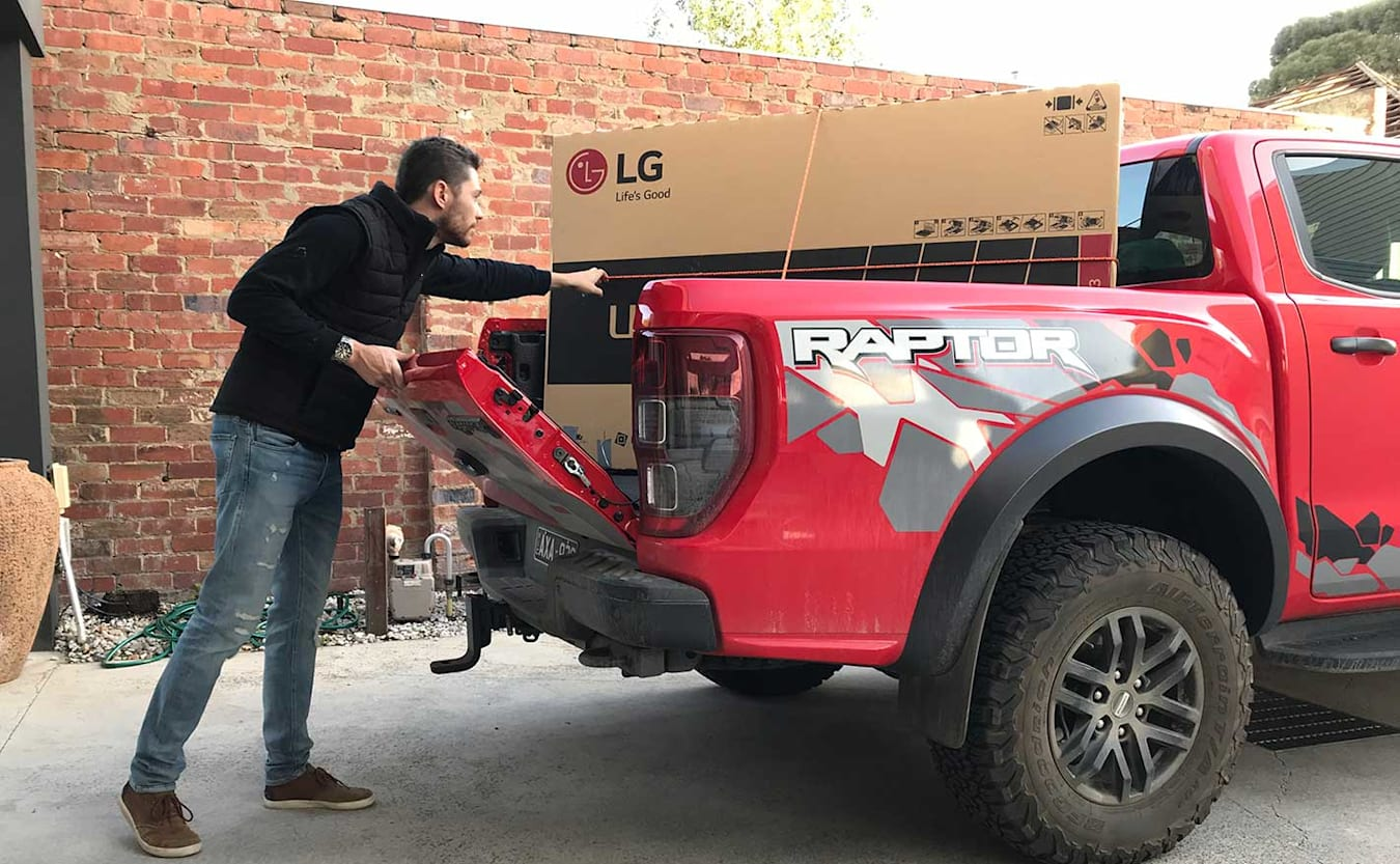 Loading the tray on a Ford Ranger Raptor