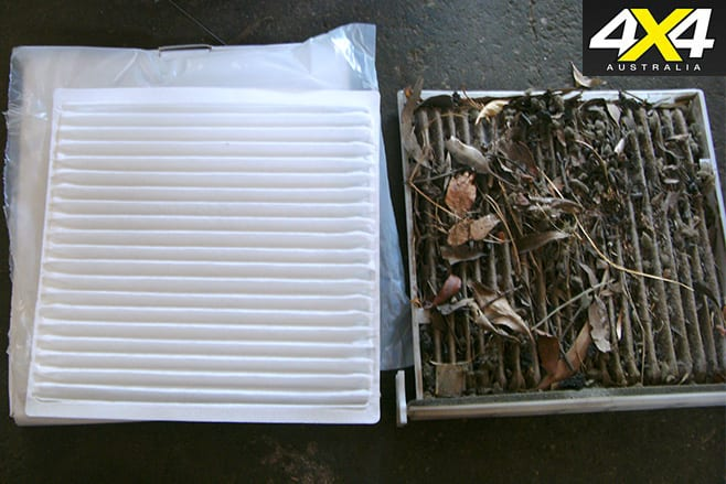 Check and clean a vehicle's air filter before a trip.