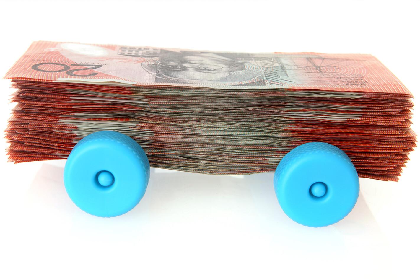 Pile Of Money On Wheels Jpg