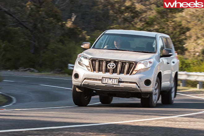 Toyota -Prado -driving -on -road -front -side
