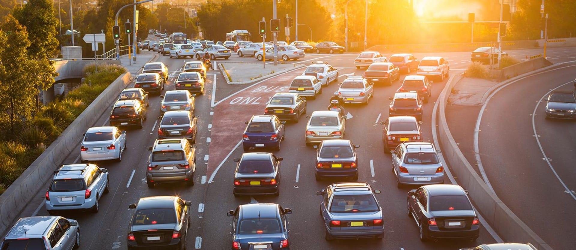 cars driving in highway traffic