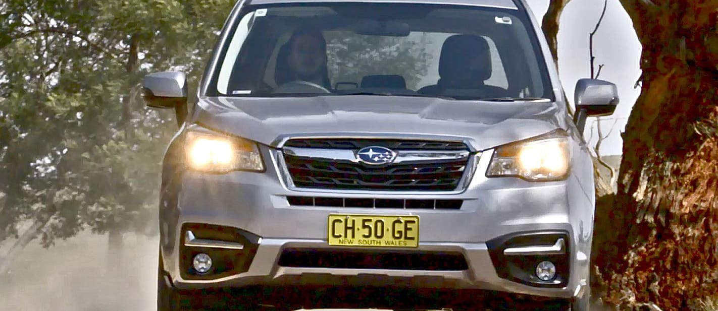 Subaru Forester Silver Driving Front On Jpg