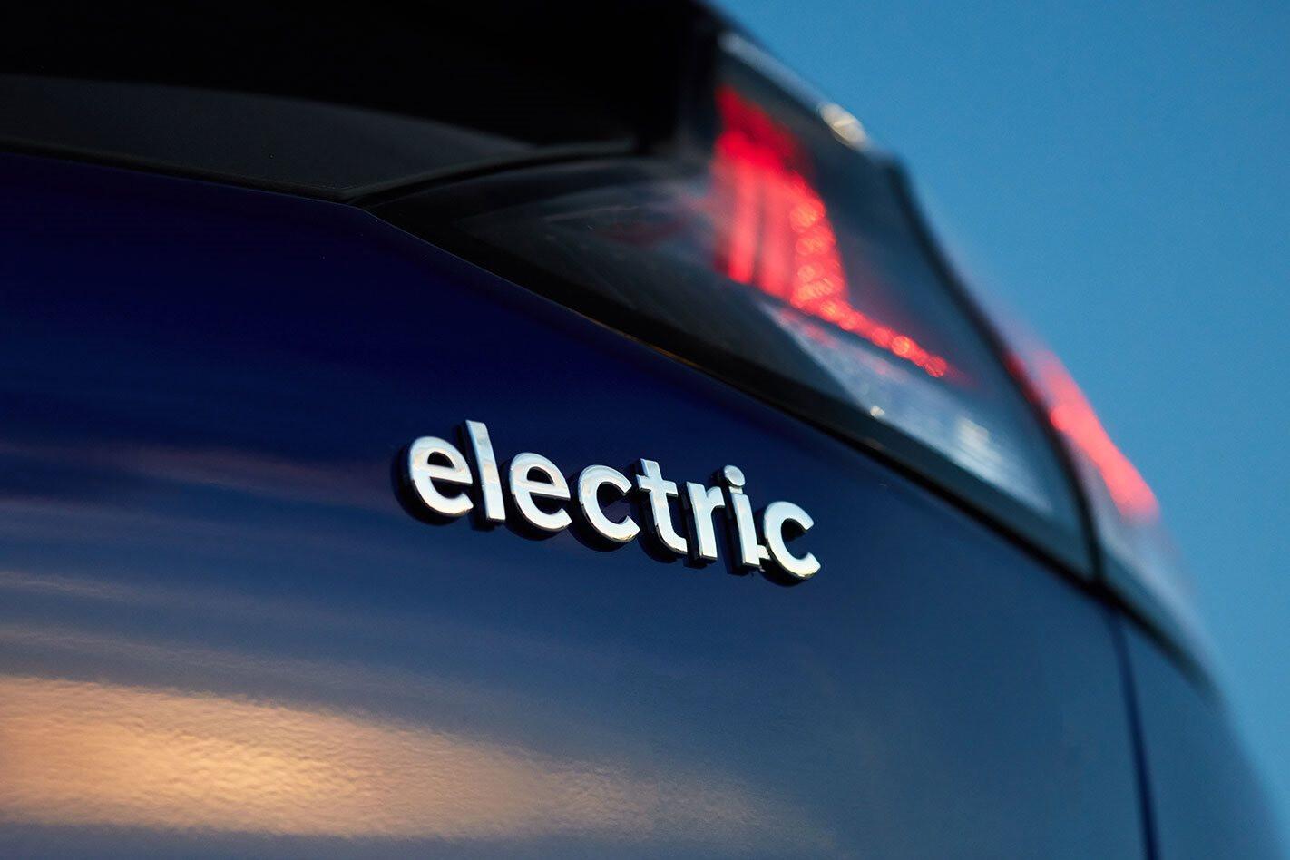 Electric vehicle badge