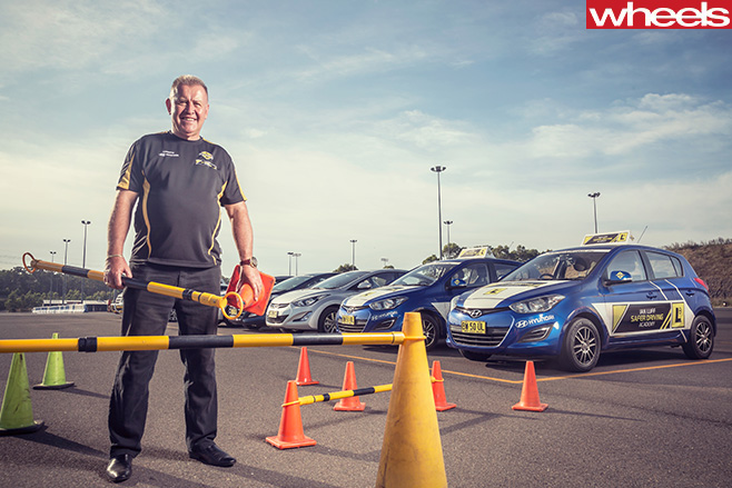 Ian -Luff -advanced -driving -course -instructor -standing -on -track
