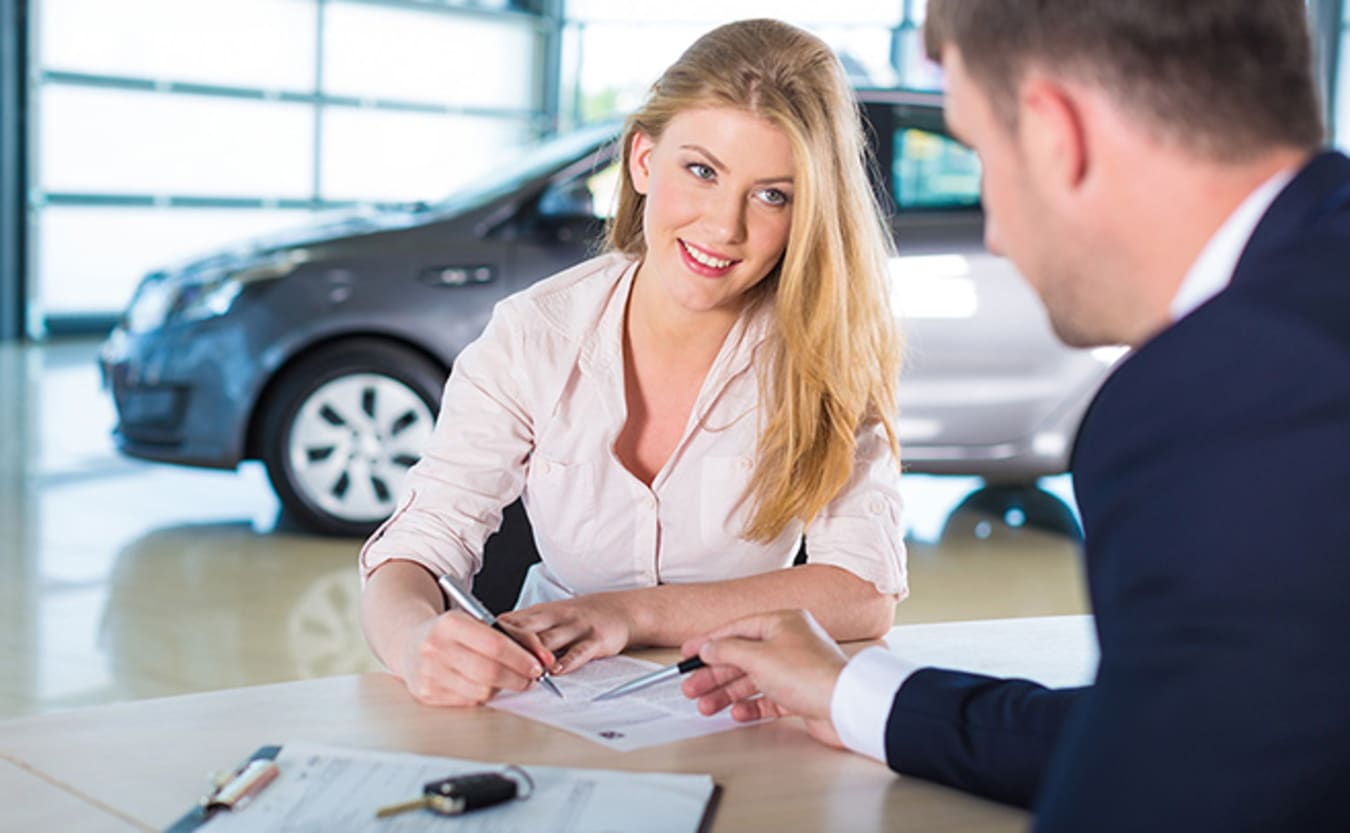 Woman signing car contract