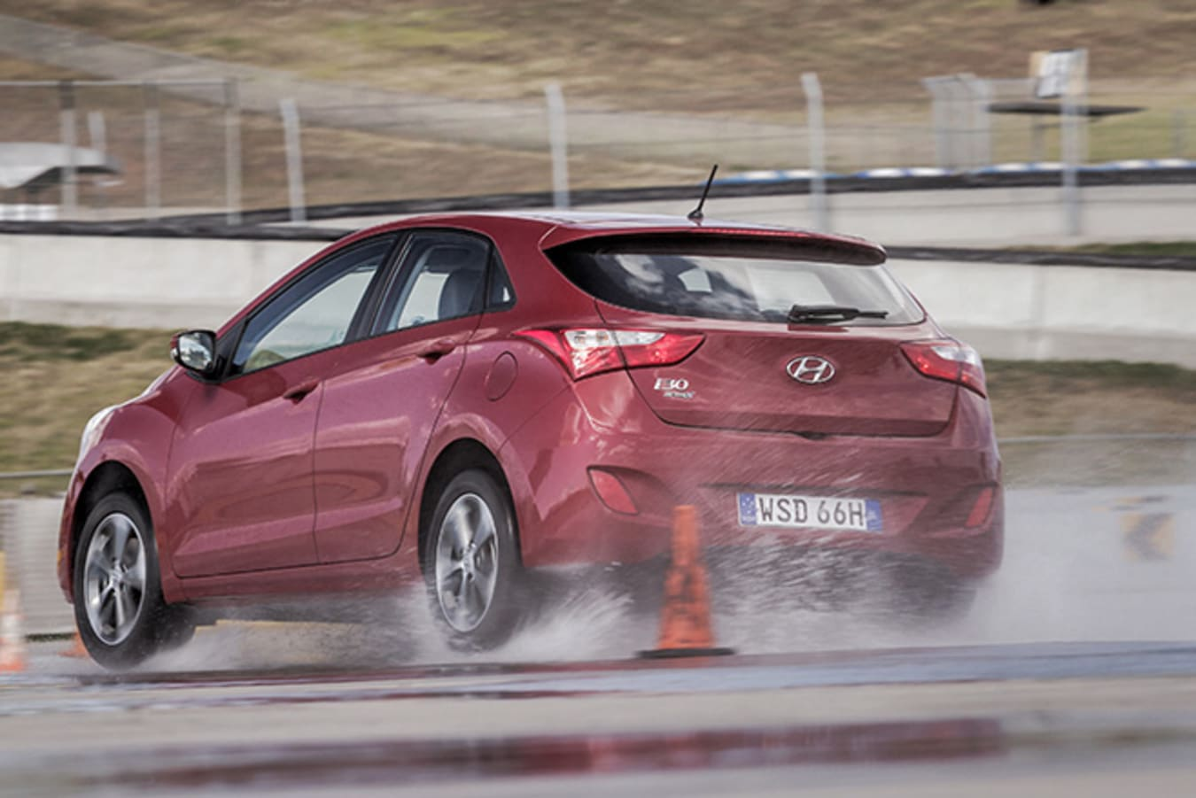 Hyundai i30 rear driving on wet road test track
