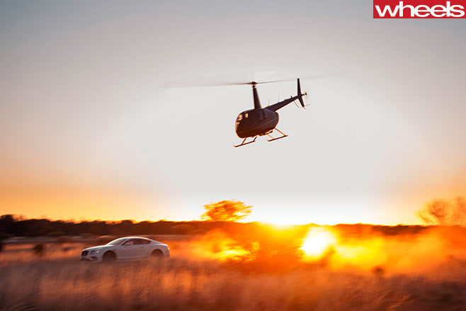 Bentley -contential -and -helicopter