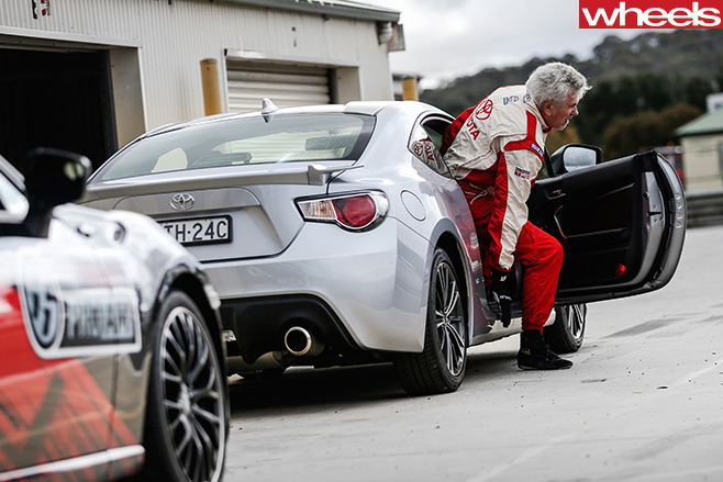 Toyota -86-Race -Car -driver -getting -out -of -Toyota -86